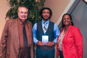 John Norris, center, of Jackson, was among Hinds Community College students recognized with a departmental award April 21. Norris received an Associated Government Award for the Jackson Campus-Academic/Technical Center, presented by Hinds President Dr. Clyde Muse, left, and instructor Dr. Marla Wiley, right. (Hinds Community College/April Garon)