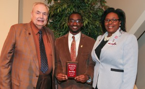 Jabari Williams, center, of Jackson, was among Hinds Community College students recognized with a departmental award April 21. Norris received an Outstanding Student Award for Leadership, presented by Hinds President Dr. Clyde Muse, left, and District Director for Student Conduct/Development Sharon Alexander, right. (Hinds Community College/April Garon)