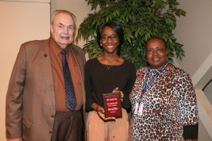 Monica Williams, center, of Jackson, was among Hinds Community College students recognized with a departmental award April 21. Williams received an Associated Student Government Award for the Utica Campus, presented by Hinds President Dr. Clyde Muse, left, and campus librarian Jean Greene, right. (Hinds Community College/April Garon)