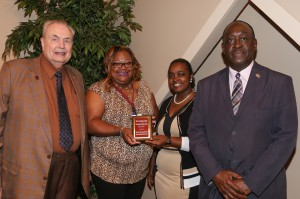 The Hinds Association of Legal Students received an award for Community Service during the departmental award ceremony April 21. It was presented by Hinds President Dr. Clyde Muse, left, Shannon Ammons, student president, Shivochie Dinkins, adviser for the organization, and Dr. Leroy Levy, dean of the Jackson Campus-Academic/Technical Center. (Hinds Community College/April Garon)