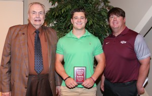 Brian King, center, of Crystal Springs, was among Hinds Community College students recognized with a departmental award April 21. King received an Outstanding Student Award for English, presented by Hinds President Dr. Clyde Muse, left, and assistant football coach Kelly Murphy, right. (Hinds Community College/April Garon)