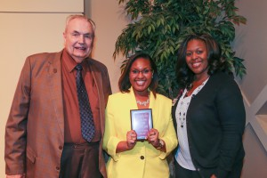 Christal Lewis, center, of Edwards, was among Hinds Community College students recognized with a departmental award April 21. Lewis received an Outstanding Student Award for Respiratory Care Technology, presented by Hinds President Dr. Clyde Muse, left, and History instructor Lashonda Eades, right. (Hinds Community College/April Garon)