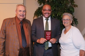 Darren Reed, center, from Newton County, was among Hinds Community College students recognized with a departmental award April 21. Reed received an Outstanding Student Award for Interpreter Training Technology, presented by Hinds President Dr. Clyde Muse, left, and instructor Sandra Hester, right. (Hinds Community College/April Garon)