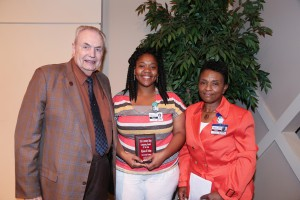 DiJonna Nelson, center, of Hermanville, was among Hinds Community College students recognized with a departmental award April 21. Nelson received an Outstanding Student Award for Dental Assisting Technology, presented by Hinds President Dr. Clyde Muse, left, and instructor Valeria Winson, right. (Hinds Community College/April Garon)