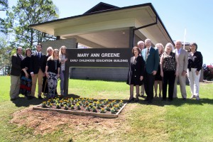 Dr. Mary Ann Greene and her family near the sign of the renamed Early Childhood Education Building (Hinds Community College/Tammi Bowles)