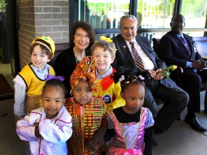Dr. Mary Ann Greene, top left, share a smile with Hinds President Dr. Clyde Muse and children in the Early Childhood Education Technology program at the Jackson Campus-Academic/Technical Center during a program March 31 to name the program's building in her honor. (Hinds Community College/Tammi Bowles)