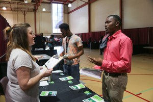 Christian Hollins, a Hinds Community College student studying Architectural Engineering Technology, speaks with Sara Sutton Thompson, of Whole Foods, at the 2017 District Job Fair at the Raymond Campus. (Hinds Community College/April Garon)