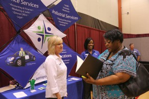 Robin Robinson, with portfolio, speaks with Michelle Rhodes and Debbie Horn, both recruiters with TempStaff, at the 2017 District Job Fair at Hinds Community College Raymond Campus. (Hinds Community College/April Garon)