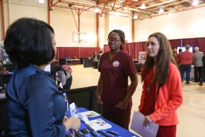 Elisha Davis, center, and Hannah Reihl, right, both studying to be hair stylists at Hinds Community College, speaks with Bridget Dedeaux, a human resources service partner at University of Mississippi Medical Center, during the 2017 District Job Fair April 12 at the Raymond Campus. (Hinds Community College/April Garon)