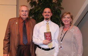 Johnathan Livingston, center, of Florence, was among Hinds Community College students recognized with a departmental award April 21. Livingston received an Outstanding Student Award for IST-Computer Programming Technology, presented by Hinds President Dr. Clyde Muse, left, and History instructor Joy Rhoads, right. (Hinds Community College/April Garon)