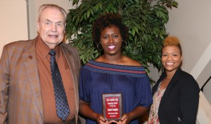 Kamesha Cunningham, center, of Waynesboro, was among Hinds Community College students recognized with a departmental award April 21. Cunningham received an Outstanding Student Award in Medical Laboratory Technology, presented by Hinds President Dr. Clyde Muse, left, and instructor LaJuanda Portis, right. (Hinds Community College/April Garon)