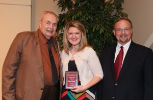 Madalyn Harkness, center, of Ecru, was among Hinds Community College students recognized with a departmental award April 21. Harkness received an Outstanding Student Award for English, presented by Hinds President Dr. Clyde Muse, left, and instructor Randy Mapes, right. (Hinds Community College/April Garon)