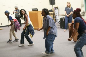 LaDaysha Washington, left, of Mendenhall, Myia Harris, of Clinton, Shantianna Thames, of Louisville, and Aliyyah Blakely, of Flint, Mich. perform a version of a skit they performed at the Southern Regional Orientation Workshop held March 10-12 at Georgia Southern University. Attendees of the conference reenacted the skit March 29 during a student event. (Hinds Community College/April Garon)