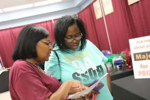 Patanya Williams, of Vicksburg, speaks wtih Joycelyn Washington, a Student Services coordinator for Hinds Community College, at College Night at the Vicksburg-Warren Campus April 18. (Hinds Community College/April Garon)