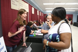Deborah Hartley, right, speaks with Kathryn Cole, district Director of Enrollment Services at Hinds Community College, at College Night at the Vicksburg-Warren Campus April 18. (Hinds Community College/April Garon)