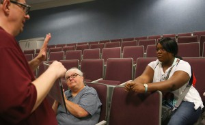 Deborah Nicole Hartley, right, listens to Shane Brown, a recruiter for Hinds Community College, during College Night at the Vicksburg-Warren Campus April 18. Her mother, Deborah Hartley, is at center. (Hinds Community College/April Garon)