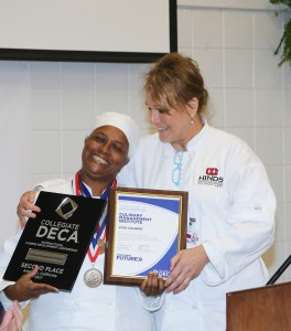 Vicki Colbert, left, and Chef Sally Porter of the Culinary Arts program at Hinds show awards Colbert won this past semester. (Hinds Community College/April Garon)