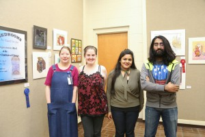 GRAPHIC DESIGN winners, from left, Kimberly Surratt, of Vicksburg, first place ; Anna Hite, of Raymond, third place; Dipannita Saha, of Jackson, honorable mention ; Gurkirt Cheema, of Clinton, second place (Hinds Community College/April Garon)