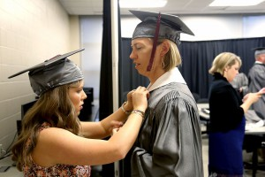Aleasha Haver of Flowood, left, and Dawn Little of Brandon get ready for their graduation with degrees in Physical Therapist Assistant from Hinds Community College on May 12.
