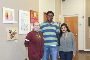 PAINTING/MIXED MEDIA winners, from left, Susan Moore, of Crystal Springs, third place ; Reginald Pickering, of Clinton, second place; Dipannita Saha, first place (Hinds Community College/April Garon)