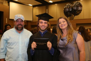 Nicholas Hydrick, center, with his father, Ryan, and his mother, Nancy Cobb (Hinds Community College/April Garon)