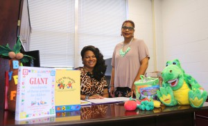 LaTina Gray, left, and Amelda Ellis with some of the materials available to child care providers at the new Early Childhood Academy on the Raymond Campus of Hinds Community College.