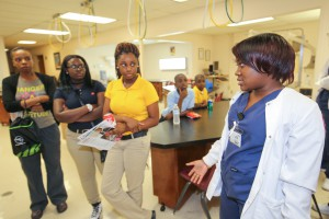 Shadonna Lewis, from left, Jayla Walker and Rayanna Lewis, all of Port Gibson, look on as pulmonary technician Jayla Hough explains the ins and outs of the Respiratory Care Technology lab at the fall 2017 Nursing Showcase on Sept. 5 at Hinds Community College Jackson Campus-Nursing/Allied Health Center. (Hinds Community College/April Garon)