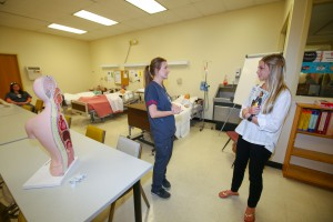 Destiny Hudson, a second-year nursing student at Hinds Community College, chats with Mary Barton Rogers, right, of Brandon, in the Associate Degree Nursing lab at the fall 2017 Nursing Showcase on Sept. 5 at Hinds Community College Jackson Campus-Nursing/Allied Health Center. (Hinds Community College/April Garon)