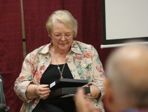 Mary Ann Sones, a retired dean of Hinds Community College Jackson Campus-Nursing/Allied Health Center, holds a personalized medallion received during a reunion Sept. 21 of former deans and instructors at the facility. (Hinds Community College/April Garon)