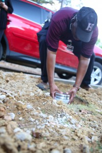 Lee Cooper, maintenance technician at Hinds Community College Jackson Campus-Nursing/Allied Health Center, buries a time capsule during a reunion Sept. 21 of former deans and instructors at the facility. (Hinds Community College/April Garon)