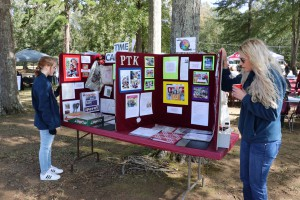 Items from a time capsule buried at Hinds Community College Raymond Campus in 1992 were displayed alongside current photos at the at the Calling All Eagles tailgate event at Hinds Community College Raymond Campus on Oct. 28, 2017. (Hinds Community College/Tammi Bowles)