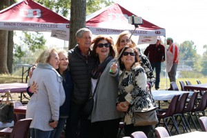 From left, Margaret Patterson Luckett, Vickie Gilmore Neely, Keith Neely, Lee Ann May, Merrill Mitchell and Connie Wicks Rice take a selfie at the Calling All Eagles tailgate event at Hinds Community College Raymond Campus on Oct. 28, 2017. (Hinds Community College/Tammi Bowles)