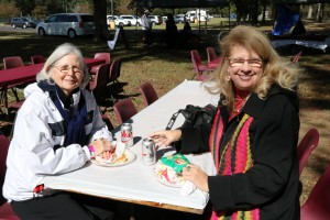 Ann Forbes, in dark coat, enjoys her plate lunch with her sister, Carolyn Forbes, left, at the at the Calling All Eagles tailgate event at Hinds Community College Raymond Campus on Oct. 28, 2017. (Hinds Community College/Tammi Bowles)
