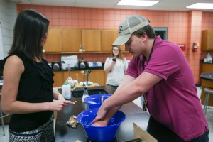 Case Jordan, of Brandon High School, dips his hands in water as chemistry instructor Amanda Blair looks on during an experiment at Honors Day at Hinds Community College Rankin Campus on Oct. 20. (Hinds Community College/April Garon)
