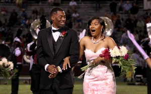DeAuntray Smith of Jackson, a Forest Hill High School graduate, left, and Kontessa McClendon of Clinton, a graduate of Clinton High School, react to her being named the 2017 Homecoming queen at Hinds Community College on Oct. 12.