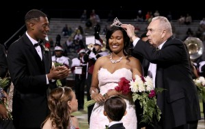 Hinds President Dr. Clyde Muse crowns Kontessa McClendon of Clinton, a graduate of Clinton High School, as Homecoming queen for 2017 at Hinds Community College. Left is McClendon's escort, DeAuntray Smith of Jackson, a Forest Hill High School graduate. The flower girl was Hallie Faye Horne and crown bearer was Jax Mitchell.