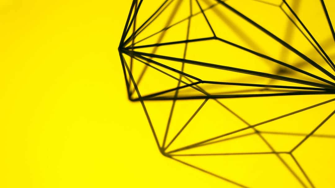 abstract wire sculpture on yellow background