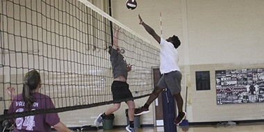 students in a volleyball match
