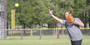 guy pitching a softball