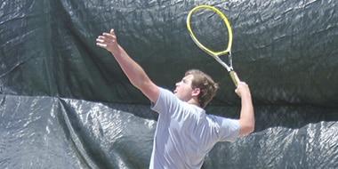 tennis player serving a shot