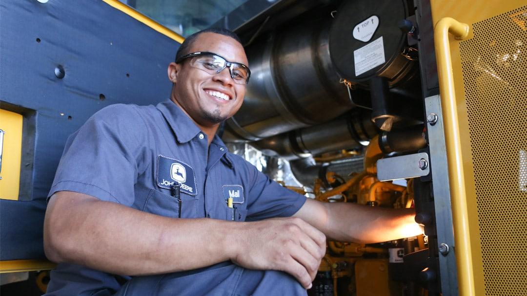 male student working on diesel engine