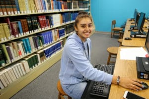 student sitting at computer desk