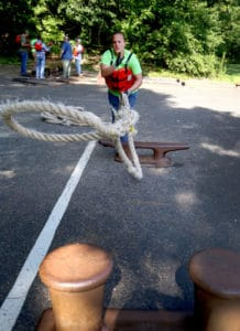 student tossing a rope