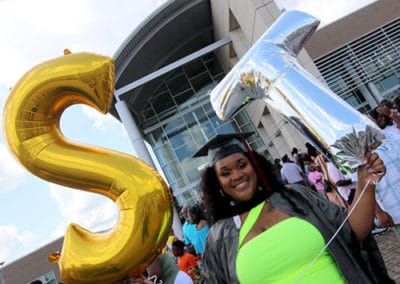 Yasmeen Love, of Jackson, holds balloons signifying the Technica