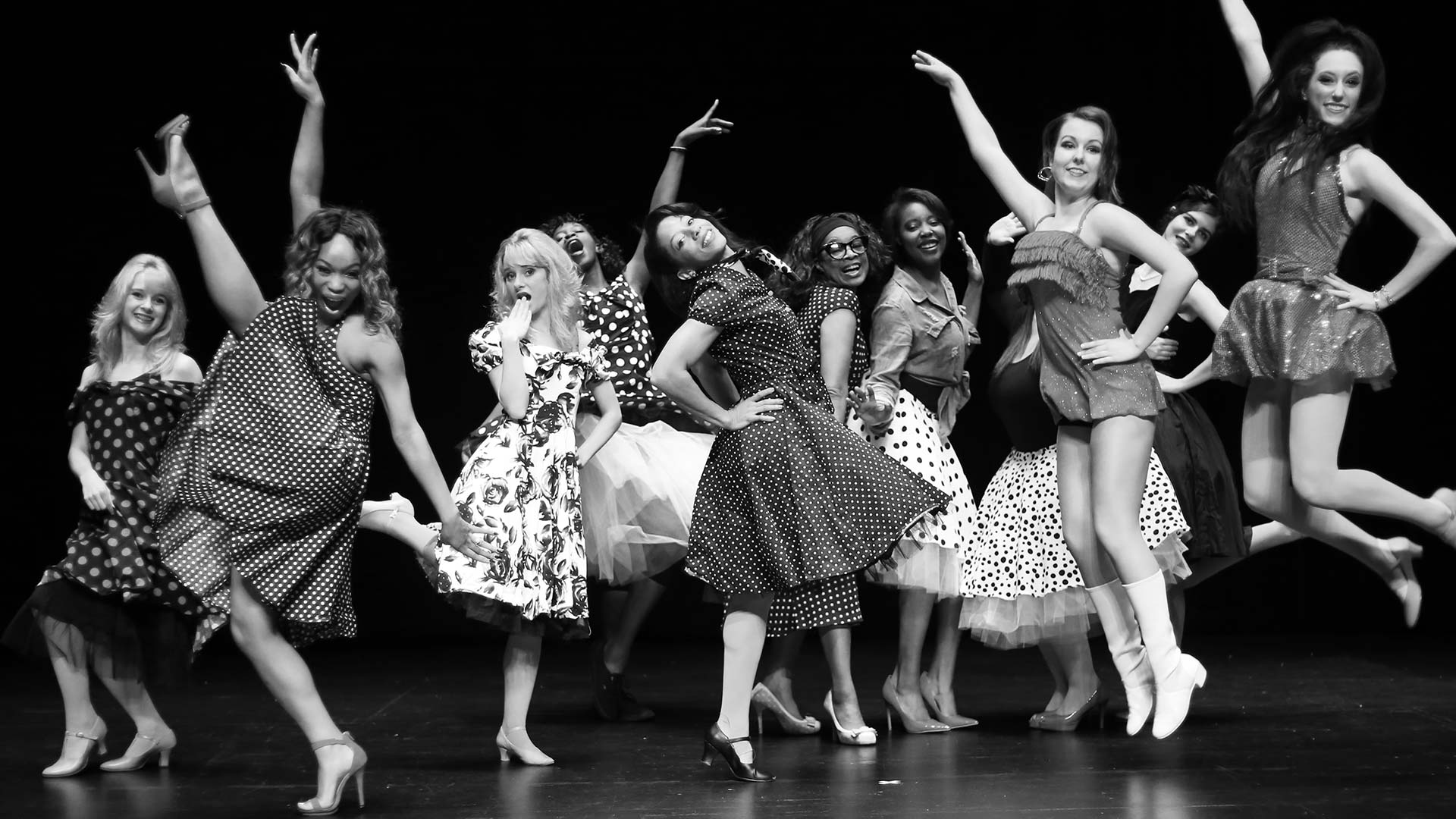 group of female dancers posing dramatically
