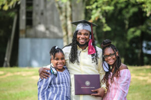 Walter Blevins, with daughters Ly'Niah, 9, left, and L'Deja, 11,